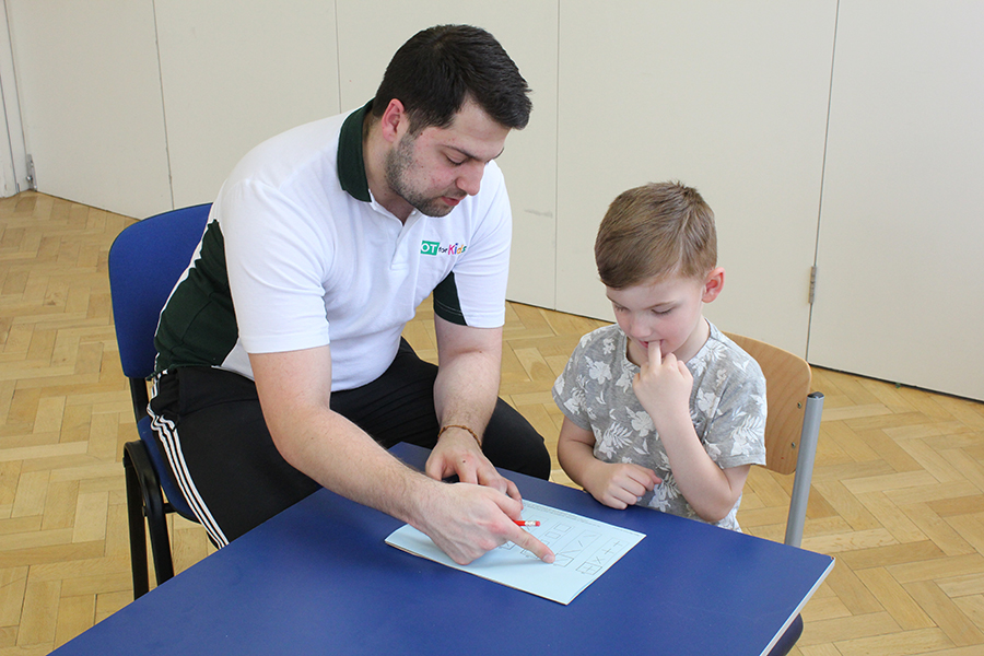 Child completing an initial assessment with therapist